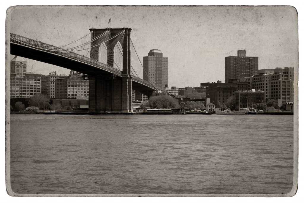shot of the Brooklyn bridge in Manhattan NYC with aged postcard effect
